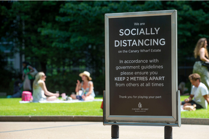 Social distancing signage in Canada Square Park